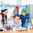 Elegant man celebrating his birthday with his wife and his child — Stock Photo