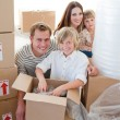 Happy family packing boxes — Stock Photo