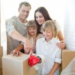 Foto de Stock  : Merry family packing boxes