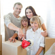 Lively family packing boxes — Stock Photo