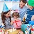 Smiling little girl celebrating her birthday — Stock Photo #10295135