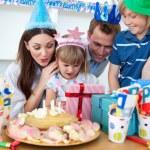 Cheerful little girl celebrating her birthday — Stock Photo