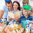 Joyful family celebrating mother's birthday - Stock Photo