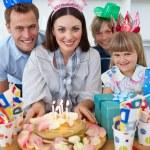 Cheerful family celebrating mother's birthday — Stock Photo