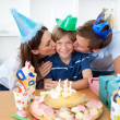 Affectionate parents celebrating their son's birthday — Stock Photo