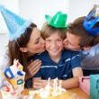 Close-up of parents celebrating their son's birthday — Stock Photo