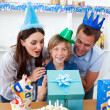 Loving parents celebrating their son's birthday — Stock Photo