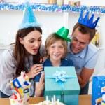 Loving parents celebrating their son's birthday — Stock Photo