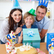 Lively parents celebrating their son's birthday — Stock Photo #10295156