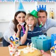 Joyful parents celebrating their son's birthday — Stock Photo