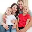 Close-up of adorable family sitting on sofa — Stock Photo