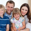 Portrait of a happy family on the sofa — Stock Photo