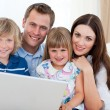 Stock Photo: Young family surfing internet