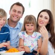 Royalty-Free Stock Photo: Happy family eating crisps