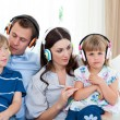 Young family listening music together — Stock Photo