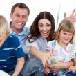 Excited family celebrating a goal — Stock Photo