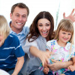 Excited family celebrating a goal — Stock Photo #10295188