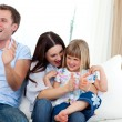 Happy family clapping a goal — Stock Photo