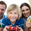 Smiling family playing video games together — Stock Photo