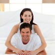 Young couple having fun on bed together — Stock Photo
