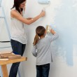 Mother and her daughter painting together — Stock Photo #10295276