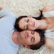 Couple sleeping on the floor — Stock Photo #10295279