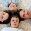 Family sleeping on the floor — Stock Photo