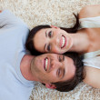Smiling Couple lying on the floor — Stock Photo