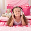 Cute girl listening music with headphones — Stock Photo