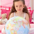 Little girl holding terrestrial globe — Photo #10295350