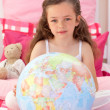 Little girl holding terrestrial globe — Stock Photo #10295350