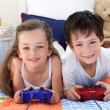 Stock Photo: Siblings playing video games together