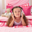 Cute girl listening music in the bedroom — Stock Photo