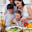 图库照片: Happy family cooking together
