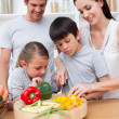 Happy parents and children cooking — Stock Photo