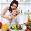 Litlle girl and her mother preparing a salad — Stock Photo #10295414