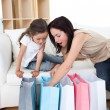 Stock Photo: Mother and daughter unpacking shopping bags