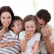 Stock Photo: Smiling family eating pizza