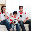 Positive family watching football match — Stock Photo #10295476
