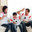 Joyful family watching football match - 图库照片
