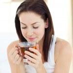 Pretty woman drinking tea — Stock Photo