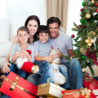 Happy family with lots of Christmas presents — Stock Photo