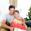 Happy little girl with her father holding a Christmas gift — Foto de Stock