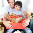 Happy father and son holding Christmas gifts — Stock Photo