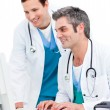 Two male doctors working at a computer - Stock Photo