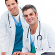 Two handsome male doctors working at a computer - Stock Photo