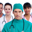 Portrait of a surgeon and his medical team — Stock Photo #10295785