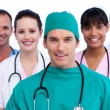 Positive surgeon and his medical team — Stock Photo #10295786