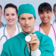 Charismatic surgeon and his medical team — Stock Photo