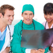 Ambitious medical team looking at X-ray — Stock Photo #10295841
